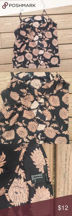 Forever 21 tank top Black and brown tank top from forever 21. Size M. Has pictures of flowers on it. Rarely worn Forever 21 Tops Tank Tops
