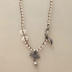 """LOVEBIRDS NECKLACE--Old-fashioned lovebirds perch on a branch beneath a strand of cultured pearls punctuated with blue topaz. Sterling silver leaf charm at hook clasp. Handcrafted Sundance exclusive. Approx. 17""""L."""