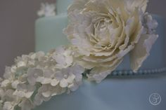 Detail from an intern cake: gumpaste blossoms and peony.  L'Art du Gâteau Graduation Showcases Edible Artistry | The French Pastry School