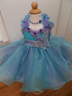 "Ready-to-Ship -Glitz Pageant Babydoll Dress ""Alyssa"" - Seafoam & Lilac w Butterfly Baby Pageant, Kids Pageant Dresses, Glitz Pageant, Pageant Wear, Pageant Girls, Ball Dresses, Girls Dresses, Toddlers And Tiaras, Embellished Dress"