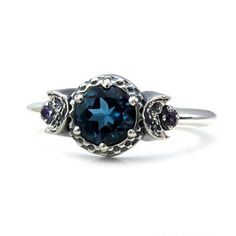 London Blue Topaz 3 Stone Moon Ring with Amethyst Side Gems - Sterling Silver Engagement Ring This super cool moon ring has a gorgeous faceted 6mm Londong Blue Topaz set in the center, representing the full moon. On either side of the Topaz is a crescent moon set with an amethyst,