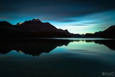 Piz da la Margna (3158m) reflected in lake Sils at sunrise. Lake Sils is located in the Swiss Engadin region. Photograph: Jarek Klimek