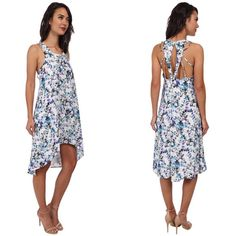 NWT Sam Edelman floral maxi cut out dress Sam Edelman floral maxi cut out dress.  Show off your shoulders in this beautiful Sam Edelman dress. Breezy polyester fabric flaunts an abstract floral print throughout. Scoop neckline. Sleeveless design. Strappy racerback design features a keyhole detail and top hook closure. High-low hemline. 100% polyester; Contrast: 95% polyester, 5% spandex. Machine wash cold, tumble dry low Sam Edelman Dresses High Low