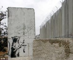 Banksy art on the Israeli separation barrier between Jerusalem and Bethlehem