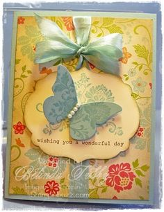 butterfly. I like so many aspects of this card. The pearls on the butterfly, the ribbon and the background paper.