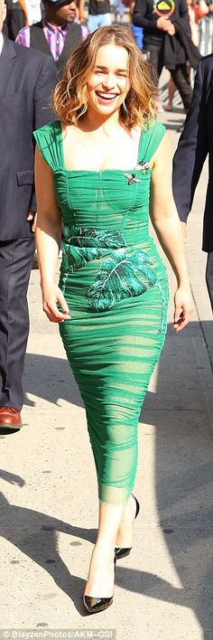 The 29-year-old British beauty sizzled in a slinky green gown adorned with leaf prints and delicate bug brooches while rocking teetering stiletto heels
