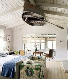Lake House idea.  Row-boat on the ceiling....i'd take it a step further...add a ceiling fan and use the oars as fan paddles...but that's just me...