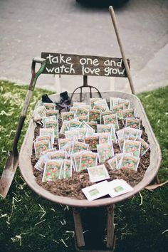 Cute seed favors displayed in a wheelbarrow