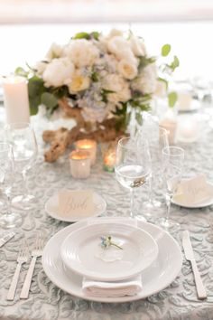 Don't love the tablecloth but the setting and flowers are nice