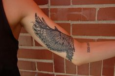 inner arm wing feather tattoo