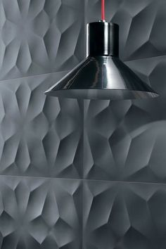 Three-dimensional ceramic surfaces for decorative walls by Atlas Concorde.