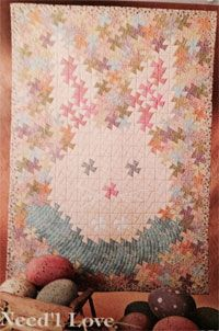 """Twister Bunny Pattern by Needl Love at KayeWood.com. 32-1/2"""" x 43-3/4"""" Twister Bunny Quilt with a pinwheel """"twist """"... designed by Amy Newman. The Twister Bunny Quilt. Quilt uses 3"""" finished squares and the Primitive Gatherings Primitive Pinwheels tool to """"twist pinwheels"""". http://www.kayewood.com/item/Twister_Bunny_Pattern/3664 $10.00"""