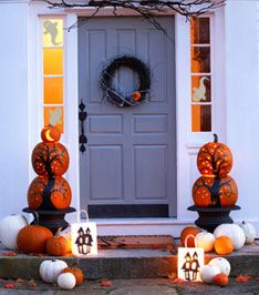 Interesting topiaries -paint & carving join two pumpkins to create this vignette