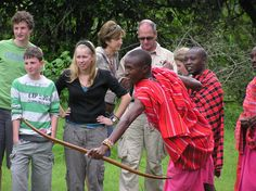 Bow and arrow lessons at the Mara Bush Houses, Maasai Mara, Kenya