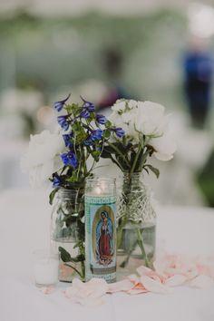 Wedding flower mason jar 7 day saint candle centerpiece details. Lauren + AJ Backyard Indie Bohemian Long Island DIY Wedding. Dress and veil: Lindsey Thornburg. Shoes: Raphaella Booz. Photographer: Chellise Michael Photography in Brooklyn, NYC
