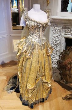 """The exhibition at the Museum of the City of New York includes the dress that Mrs. Cornelius Vanderbilt wore to the Vanderbilt ball. Designed by Charles Frederick Worth, the most famous Parisian couturier of the day, and made of satin, velvet, and silver bullion, Mrs. Vanderbilt's costume was meant to represent """"Electric Light,"""" in honor of Thomas Edison's new power station in New York."""