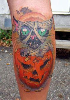 Google Image Result for http://www.galleryoftattoosnow.com/JonvonGlahnOldeTownTattooHOSTED/images/gallery/medium/halloween-black-cat-in-a-pumpkin-color-leg-tattoo.jpg