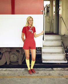 Auto-Train Corporation's attractive female Boarding Hostess is ready to welcome passengers aboard the train at the ATC station in Sanford, Florida, 1976