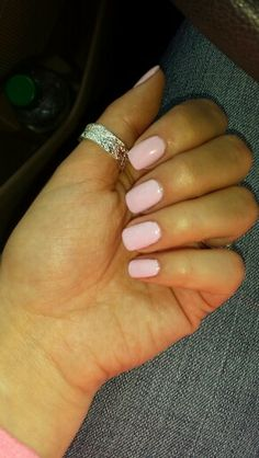 Light pink shellac nails.