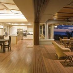 i like how the door track is flush..no tripping to outside  nano door tropical dining room by Tervola Designs