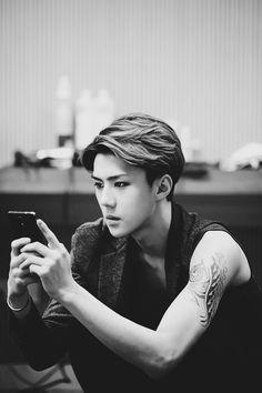 Looking at my phone to look at him looking at his phone.