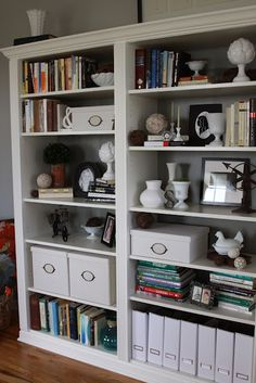 Ikea Billy Bookcases made to look like custom shelving.  Inexpensive!