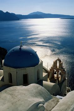 One of the most taken images: 'Overhead of Orthodox church with ocean beyond.' by Lonely Planet Images