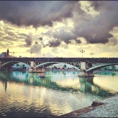 Triana bridge. I walk over this every day in Sevilla. This place is so ridiculously beautiful.
