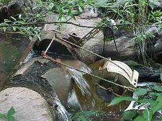 Simple homebuilt water wheel to generate 500 watts of power per day, with a few modifications and a 20 inch head.  Wow!