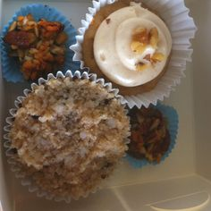 The simply cake company' cheat day box with absolute health.  1  carrot cupcake 1 apple and walnut cupcake with cinnamon cream cheese 2 honey nut cookie clusters  Does your gym do this?:) love it