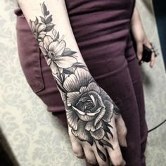 Black Floral Arm Tattoo