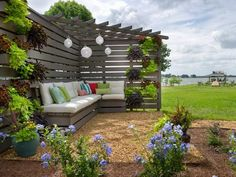 Compact Pergola/Patio Design for smaller space. Top treatment offers stability & plant climbing. In this big yard, looks kinda hokey and underscale. Blog Cabin 2014