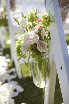 Mason Jar flowers looped over chairs along aisle or on Shepherd's hooks.