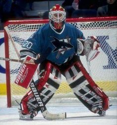Ed Belfour with the Sharks playing with his Chicago gear. Goalie Pads, Hockey Goalie, Hockey Games, Eddie The Eagle, San Jose Sharks, Vancouver Canucks, Nfl Fans, National Hockey League, Eagles