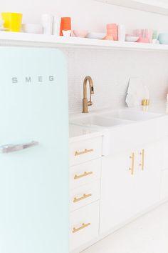 Pal blue Smeg fridge and pastel dishes and glasses