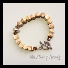 "Picture Perfect...is created using lovely picture jasper pillows, swarovski crystals and silver plate bead and toggle style clasp. This one and only piece measures just a squeak over 7""!!"