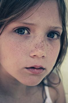 freckles are beautiful and so is this little girl there is a saying that freckles are like stars in the sky