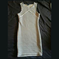 """Forever 21 stripe bodycon dress Sleeveless stripe dress.  Tan dress with black stripes.  Full length: 32.5"""" long  Worn once for a few hours. Still new. Forever 21 Dresses Mini"""