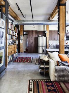 There's so much to love here. Kilim rugs, exposed ducts, and wood!