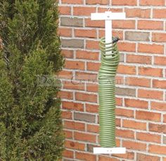Coiled Garden Hose Holder at SkyMall for 3997 Garden Hose