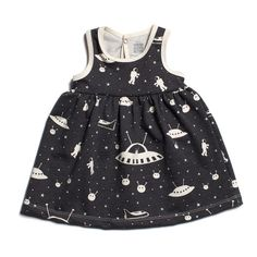 This adorably cartoon-y dress with a circular gathered skirt is covered in stars, planets, astronauts...and aliens. For your littlest stargazer. Made in Brooklyn of 100% organic cotton.