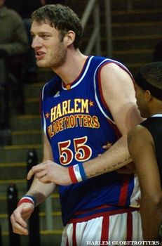 "Paul ""Tiny"" Sturgess - the world's tallest basketball player, dunks - without jumping!  Needs to be seen to believed!"