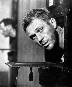 Steve McQueen, Papillon (1973)  Amazing that I just watched this film tonight! Papillon found guilty of a wasted life!