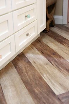 Using modern print manufacturing techniques vinyl producers can create bathroom safe vinyl flooring that looks like natural materials.