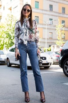 4dc425ff7ec6 May street style teaming a ladylike pussy-bow blouse with jeans for an  elegant ensemble