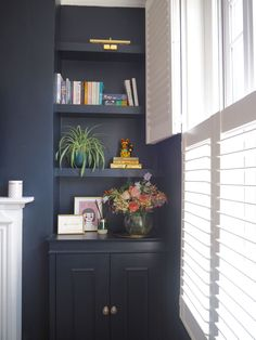 If you like bold interiors youll love Jess from Gold Is A Neutrals contrasting, dark blue living room with white shutters that add drama to the space. We love this shelving, a perfectly styled corner in Jesss home. Alcove Ideas Living Room, Corner Sofa Living Room, Living Room Shelves, Living Room Storage, Living Room Decor, Blue Lounge, Dark Blue Living Room, Small Living Rooms, Blue Corner Sofas