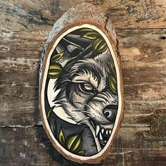 Wood slice with an original drawing of a wolf