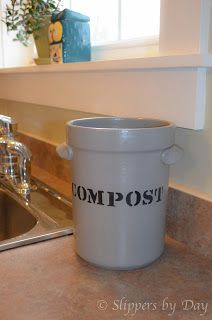 a small bucket under sink for compost