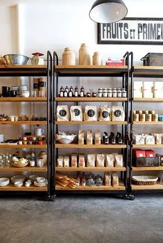 Mobile shelving units.....good to be able to change it up. I like the wood/metal!