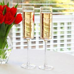 @Overstock - Sleekly styled and ideal as wedding and housewarming gifts, these champagne flutes are both fun and functional. Custom etched with Mr. and Mrs. vertically on the bell of each flute, the shapely stemware is great for accompanying every newlywed?s big day.http://www.overstock.com/Home-Garden/Mr.-Mrs.-Contemporary-Champagne-Flutes/7662451/product.html?CID=214117 $29.99